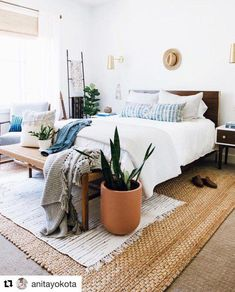 Potted plants are great to bring life into a room. We love layering smaller textured rugs over a big jute rug. Romantic Bedroom Decor, Bedroom Vintage, Bedroom Inspo, Bedroom Ideas, Indigo Bedroom, Bedroom Inspiration, Interior Inspiration, Design Inspiration, Cute Dorm Rooms