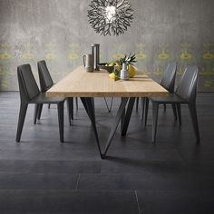 The Morgan Fixed Table provides stylish legs with a solid Canaletto walnut top - great for a simple dinner or entertaining.