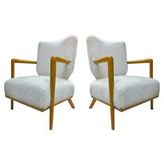1stdibs.com | Jean Royere Genuise Model Ecusson Pair Of Oak And Faux Fur Lounge Chairs, ca.1950's-60's