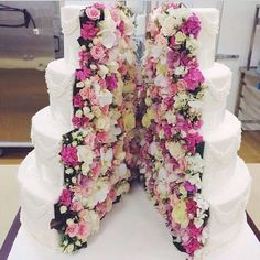 Gorgeous. Wedding cake split down the middle with flowers inside!