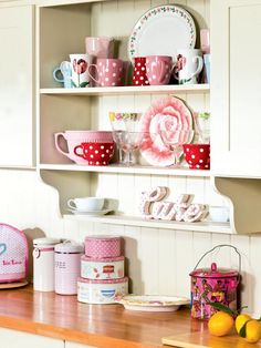 Love the red, white and pink in this kitchen/dining area.