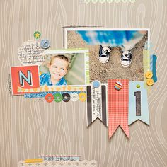 flag banner under photo made from tags cut into pennant shapes-- do this! #scrapbooking #layout #embellishment