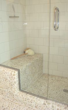 Pebble Tile actually the shower floor is pebble tile and the wall is a small subway tile..kind of like this!