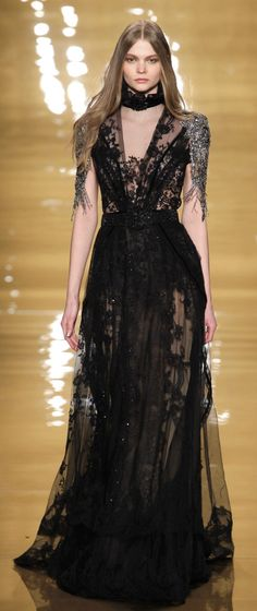 Reem Acra Fall 2015 RTW | Embroidered black lace gown with platinum jeweled tulip sleeves.