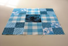 "A traditional block pattern called ""Thrifty"" pieced by Pam Wilson in July 2014, incorporating gingham and other fabrics from the stash of my aunt Johanna Wackerle Tanner."