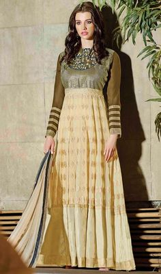 Look dashing wearing this cream and mehendi green color georgette long Anarkali dress. You'll see some fascinating patterns done with lace, patch, resham and sequins work. #floorlengthanarkalisuit #longanarkalidress #anarkalichuridarsuit