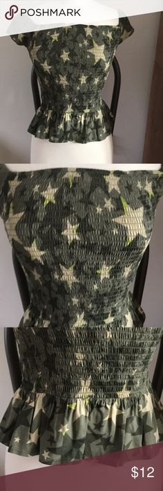 Candie's top Hunter green with beige stars scattered throughout top . Ribbed , form fitting top with flair skirt bottom . Super cute ! Candie's Tops