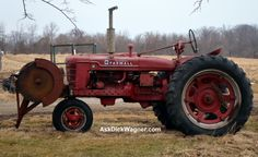 Old Farmall tractor circa 1950-ish.  Used to drive one of these to bale hay and spread manure.  Fremont, Ohio farm area