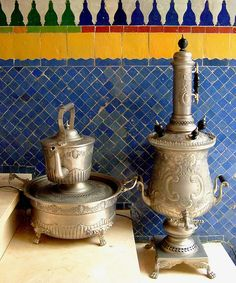 This gives a feel for Moroccan tilework & its beautiful coloration and patterning. I took this picture in the Soundouss Hotel in Rabat Morocco. The metal tea/water items are vintage & probably originally from Fez. Image by Maryam Montague of the My Marrakesh Blog, www.mymarrakesh.com