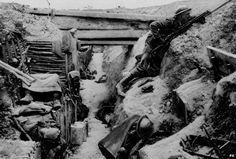 A British Grenadier Guardsman keeps watch on 'No-Man's land' as his comrades sleep in a captured German trench at Ovillers during the Battle of the Somme in 1916