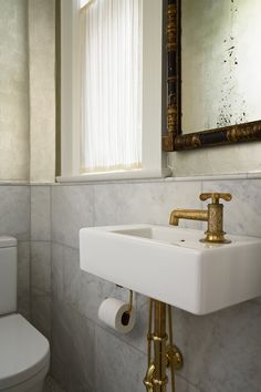 Attirant Gold Faucet And Wall Hung Sink In Powder Room Made Out Of Closet Small  Waterworks Henry Faucet Brsss