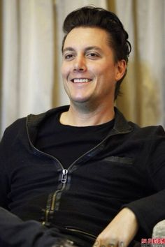 Synyster Gates...smiling and that has been a rarity in photos lately