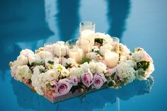 Beautiful floating flowers - perfect ceremony decoration by pool side weddings