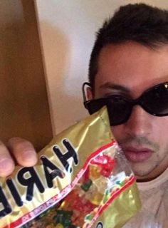 does he just put on sunglasses and pick up random food to take selfies or do they just happen to be there