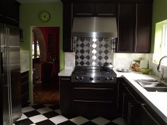 Chartreuse walls, dark Shaker cabinets and a  Black and White Harlequin floor gives this LA home a retro feel.