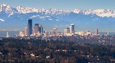 Seattle with the Olympic Mountains behind.   Beautiful.  I see this all the time.  Lucky.