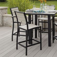 POLYWOOD Euro Bar Side Chair is truly a performance-driven outdoor bar chair.  This Poly-Wood™ Euro Collection Bar Side Chair pairs the weather resistant aluminum frame with  POLYWOOD Slats which are also weather resistant.  What does that mean for you?  It means no sanding, painting or refinishing as well as easy clean up with soap and water as needed!  Sophistication and style delivered to your doorstep.  We couldn't make it any more convenient!