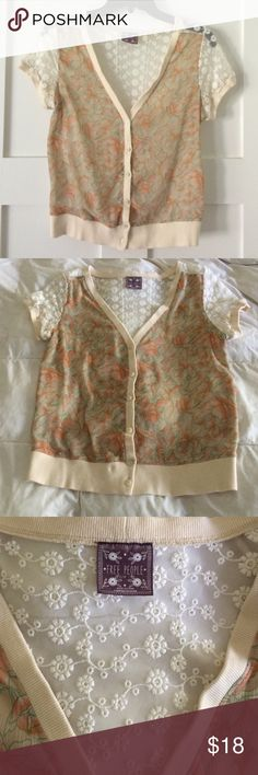 """Free People lace blouse/shrug Gorgeous Free People short sleeved shrug with muted floral pattern on front and delicate lace design on sleeves and back.  20"""" shoulder seam to bottom. V-neck, button down and banded waist. Dress it up or down, perfect for layering any season! Free People Tops Blouses"""
