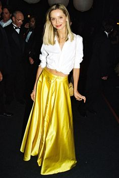 The Best Emmys Dresses Of All Time #refinery29. The crisp white shirt rocks the metallic yellow ball skirt. Calista Flockhart, 1999 photo: beimages