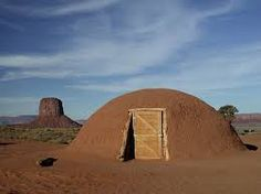 Navajo Hogan. The log structures are covered with a mud exterior for warmth.
