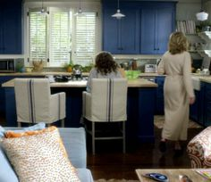 Grace And Frankie Beach House Kitchen With Bright Blue Cabinets And Linen  Slipcovered Bar Stools.