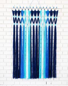 Follow this tutorial to DIY an easy yarn backdrop.