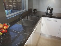 Tiling Tiles are a somewhat strange option for a kitchen bench, the fact they have joiner in the middle can make them very hard to clean. Black Kitchen Decor, Kitchen Decor Themes, Granite Countertops Colors, Kitchen Countertops, Best Kitchen Cabinets, U Shaped Kitchen, Kitchen Benches, Kitchen Styling, House Rooms