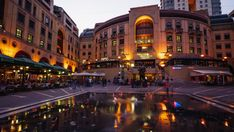 Nightfall at the Nelson Mandela Square in Sandton, Johannesburg overlooking statue of Nelson Mandela next to the restaurants and fountain. Sandton Johannesburg, City Scene, Photo Boards, Nelson Mandela, Hd Video, Luxury Lifestyle, Stock Footage, South Africa, Fountain