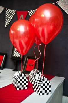checkered gift boxes and balloons