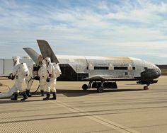 Recovery crew members process the X-37B Orbital Test Vehicle at Vandenberg Air Force Base after completing 674 days in space. A total of three X-37B missions have been completed, totaling 1,367 days on orbit.   Photo: Boeing