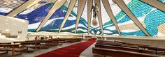 Cathedral of Brasília designed by Oscar Niemeyer , 1970, allows light in and out for almost the full height of the ribs