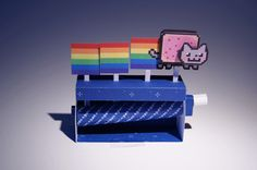 Nyan Cat Machine - Automata Papercraft - by Ddi7i4d - via DeviantArt       --   This nice automata paper model was created by German designer Ddi7i4d. You can download this free papercraft with detailed instructions at Ddi7i4d`s page at DeviantArt.