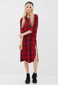 Red+and+Black+plaid.+Shirt+dress.+Cotton.+White+numbering+on+the+back.+Side+slits.+  Can+be+pair+with+a+Black+pair+of+Doc+Martens+and+high+Black+striped+socks