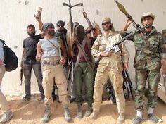 Matthew VanDyke with fellow rebel fighters at the battle for Sirte University, Sirte, Libya War