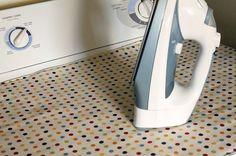 diy magnetic ironing mat on top of the dryer