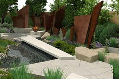 Interesting use of angles to add dynamic feel to a small garden -Telegraph Garden, RHS Chelsea 2016.