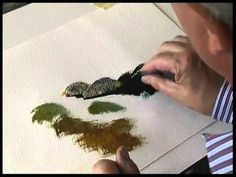 Terry Harrison painting rocks in watercolour using a credit card