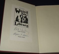 Signed limited first edition of The Devil's Auction by Robert E. Weinberg