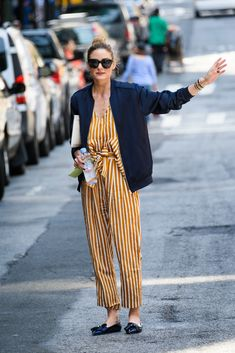 Olivia Palermo Photos - Olivia Palermo is seen out hailing a cab in NYC on June 2, 2016. Olivia Palermo Steps Out in Stripes