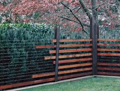 WA design-- The wood is cedar and the posts are corten steel wide flange approx 6x6 in section bolted onto a concrete curb.