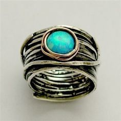 Sterling silver integrated rose  gold ring inlaid blue opal - Imagine life in peace 2. $198.00, via Etsy.