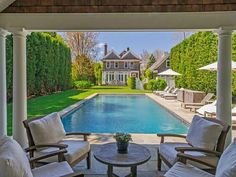 Even at Brooke Shields Hamptons home, she uses the classic style teak furniture around her  pool.
