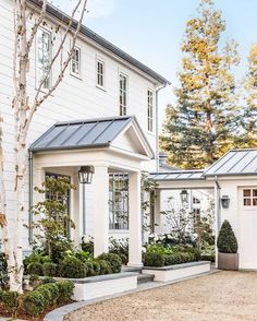 Love this exterior by @giannettihome @velvetandlinen #breezeway #portico #metalroof