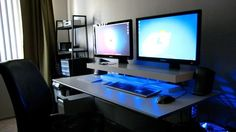 Dual Screens, Blue LEDs, and a DIY Desk Shelf,Repurposing Things to do in a DIY home office. Today& featured office includes a DVD rack cleverly put to use as a monitor stand. Dual Monitor Computer Desk, Cool Computer Desks, Gaming Desk, Monitor Stand, Gaming Setup, Computer Gadgets, Small Computer, Gaming Rooms, Home Office