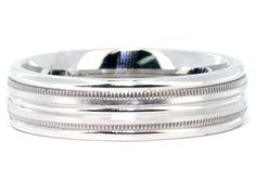 This men's band has a double milgrain edge with a ribbed band and has a high polish & satin finish.