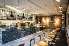 This Starbucks, located in Amsterdam's historic Flower Market, features a large floral mural while rustic bricks, marble countertops and wood planks resemble an old florist's shop. inspir starbuck, flower shops, bloemenmarkt amsterdam, store design, design blogs, flowers, flower market, market inspir, starbucks