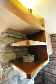 Fallingwater/Edgar Kaufman House / 1413 Mill Run Road, Mill Run, Pennsylvania / 1936-1939 / Frank Lloyd Wright -- These small shelves showcase Wright\'s design flair, as well as his dedication to having shelves and tables cantilever out from the stone walls.