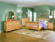 I think I might want light wood for a bedroom set. I like this one.