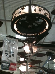 As I was investigating lighting options recently for a Kitchen Re-design I came across this Ceiling Fan/Drum shade design at Lowes. I just love it!