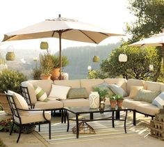 Outdoor furniture styled with creams, tans, light blues, greens - Riviera Sectional Components | Pottery Barn